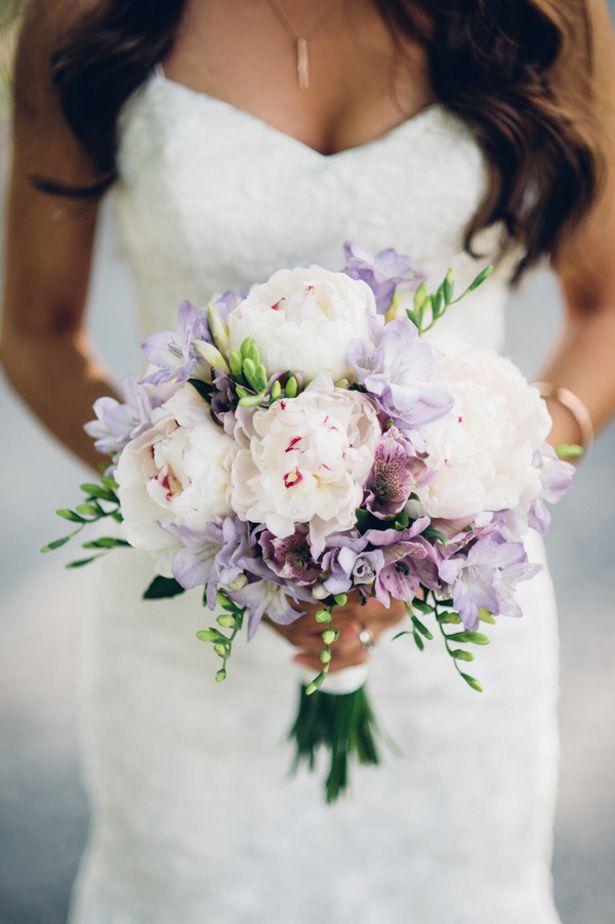 Bruidsboeket bij trouwjurk